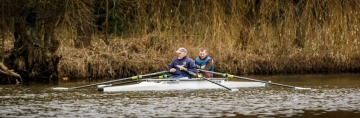 2 Mixed Ability Rowers out on the water