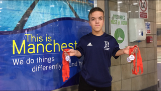 Leo McCrea holding his 4 medals at the National Para-Swimming 2017 Championships at Manchester