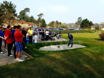 One of the teaching professionals demonstrating bunker play
